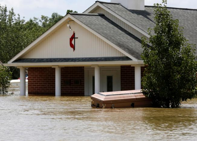 A casket is seen in front of a partially submerged church in Ascension Parish, Louisiana. Photo: christianpost.com